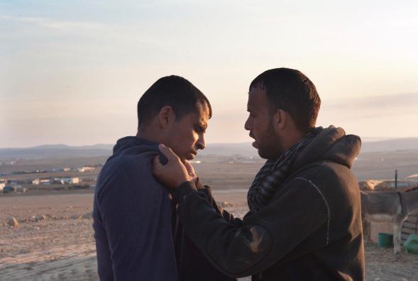 Two brothers, two viewpoints: Khaled (Ednan Abu Muhrab) and Kamal (Ednan Abu Wadi)
