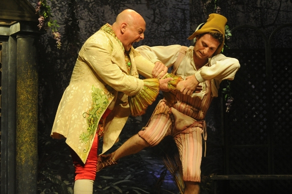 Fessenio (Vitali Friedland) messes with the mind and hand of his pseudo-boss Calandrio/Photo: Gadi Dagon
