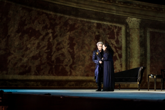 Scarpia (Scott Hendricks) and Tosca (Ira Berman) against a marble background/Photo: Muperphoto